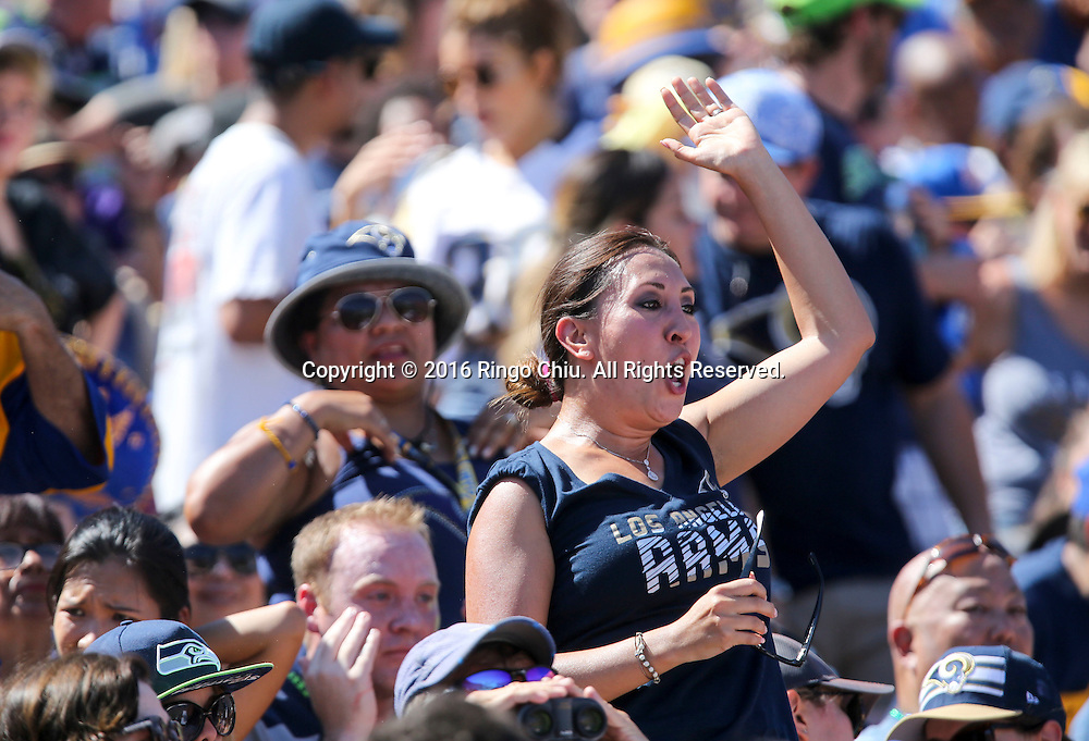Los Angeles Rams fans celebrate during a NFL football game against Seattle Seahawks, Sunday, Sept. 18, 2016, in Los Angeles. The Rams won 9-3.(Photo by Ringo Chiu/PHOTOFORMULA.com)<br /> <br /> Usage Notes: This content is intended for editorial use only. For other uses, additional clearances may be required.