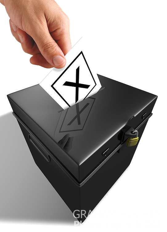 """Male hand placing """"X"""" Voting Slip into opening in lid of Traditional  Ballot Box."""