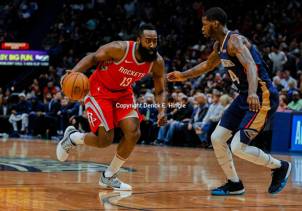 Jan 26, 2018; New Orleans, LA, USA; Houston Rockets guard James Harden (13) drives past New Orleans Pelicans guard DeAndre Liggins (34) during the second quarter at the Smoothie King Center. Mandatory Credit: Derick E. Hingle-USA TODAY Sports