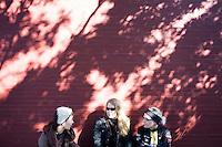 """9 Novembre, 2008. Brooklyn, New York.<br /> <br /> Tre ragazze siedono vicino all'entrata della caffetteria Gorilla Coffee Inc., nella Fifth Avenue a Park Slope, Brookyln, New York. Park Slope, spesso definito dai newyorkesi come """"The Slope"""", è un quartiere nella zona ovest di Brooklyn, New York, e confinante con Prospect Park.  Park Slope è un quartiere benestante che ha il maggior numero di nascite, la qualità della vita più alta e principalmente abitato da una classe media di razza bianca. Per questi motivi molte giovani coppie e famiglie decidono di trasferirsi dalle altre municipalità di New York a Park Slope. Dal punto di vista architettonico, il quartiere è caratterizzato dai brownstones, un tipo di costruzione molto frequente a New York, e da Prospect Park.<br /> <br /> ©2008 Gianni Cipriano for The New York Times<br /> cell. +1 646 465 2168 (USA)<br /> cell. +1 328 567 7923 (Italy)<br /> gianni@giannicipriano.com<br /> www.giannicipriano.com"""