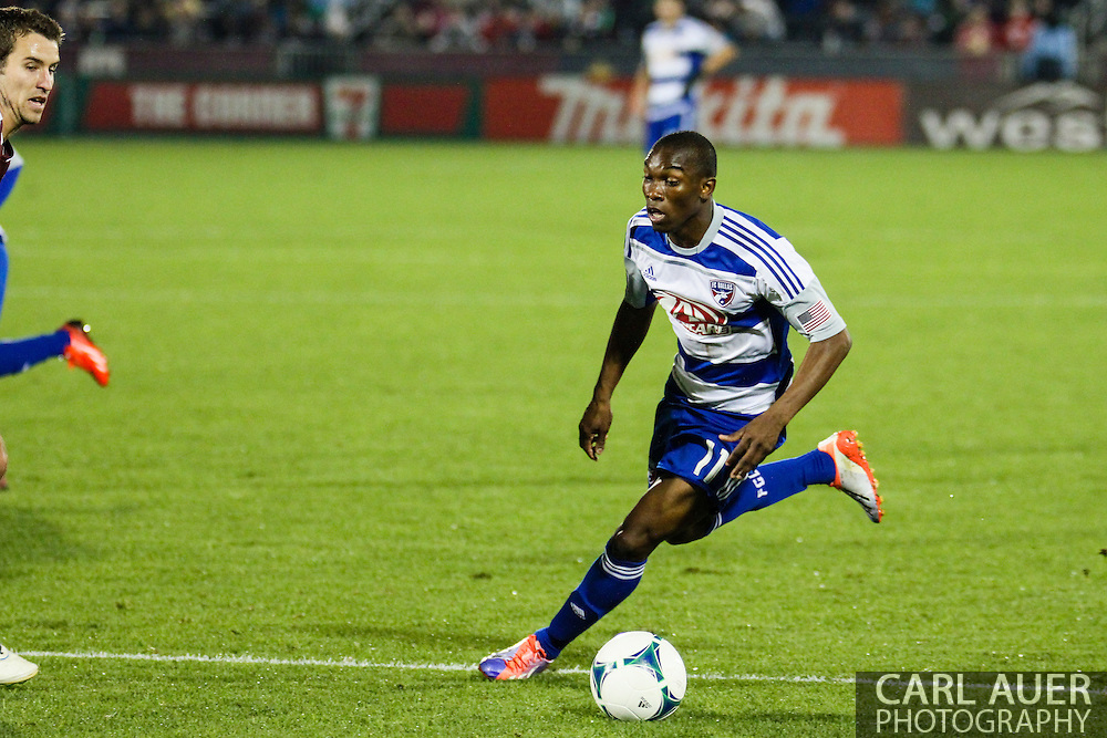 September 14th, 2013 -  FC Dallas forward Fabian Castillo (11) brings the ball up the pitch in the second half of the MLS Soccer game between FC Dallas and the Colorado Rapids at Dick's Sporting Goods Park in Commerce City, CO