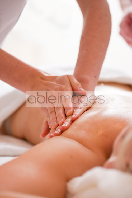 Close up of a masseur hands giving a woman a massage