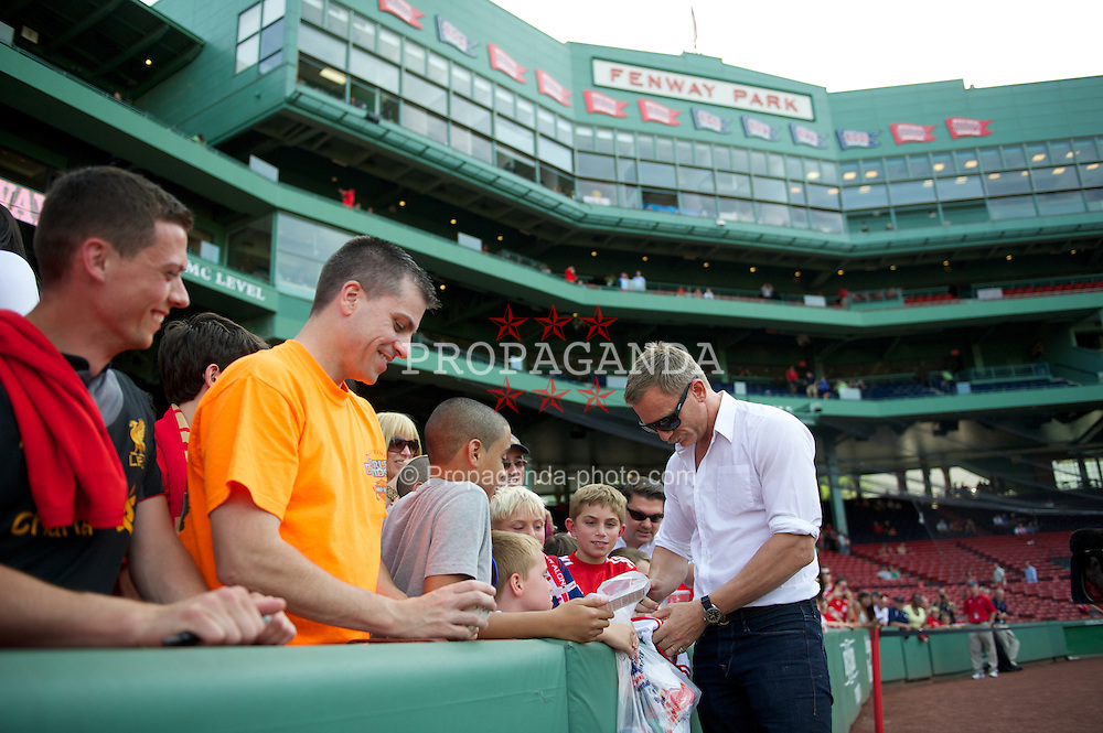 BOSTON, MA - Wednesday, July 25, 2012: Liverpool supporter and James Bond actor Daniel Craig signs autographs for fans before a pre-season friendly match at Fenway Park, home of the Boston Red Sox, the second match of the Reds' North American tour. (Pic by David Rawcliffe/Propaganda)