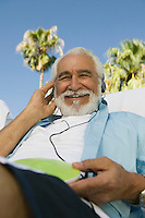 Senior Man Listening to Music on Headphones