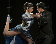The Chilean couple of Carolina Andrea Llanos Andrade (L) and Felipe Pablo Andres Almonacid Villegas dance during the semifinal round of the Stage Tango competition at the Tango Dance World Championship in Buenos Aires on August 25, 2012.   AFP PHOTO / Alejandro PAGNI