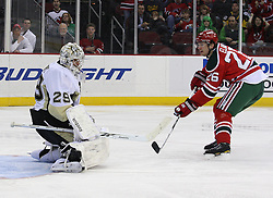 Mar 17, 2010; Newark, NJ, USA; New Jersey Devils left wing Patrik Elias (26) scores a goal by Pittsburgh Penguins goalie Marc-Andre Fleury (29) during the second period at the Prudential Center.