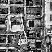 DETROIT, USA - JUNE 12, 2015: A collapsed tower, broken windows, and graffiti at the old Fisher Body Works factory highlight the post-industrial urban dilemma in Detroit. The factory was opened in 1919 and closed in 1984.