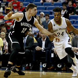 Jan 20, 2017; New Orleans, LA, USA; New Orleans Pelicans guard Buddy Hield (24) drives past Brooklyn Nets forward Joe Harris (12) during the first quarter of a game at the Smoothie King Center. Mandatory Credit: Derick E. Hingle-USA TODAY Sports