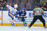 PENTICTON, CANADA - SEPTEMBER 16: Markus Niemelainen #80 of Edmonton Oilers checks Marc-Olivier Roy #57 of Vancouver Canucks on September 16, 2016 at the South Okanagan Event Centre in Penticton, British Columbia, Canada.  (Photo by Marissa Baecker/Shoot the Breeze)  *** Local Caption *** Markus Niemelainen; Marc-Olivier Roy;