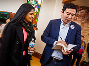 27 APRIL 2019 - STUART, IOWA: ANDREW YANG, candidate for the Democratic nomination for the US presidency, left, talks to a person at the Reaching Rural Voters Forum in Stuart. The forum was an outreach by Democrats in Iowa's 3rd Congressional District to mobilize Democratic voters statewide. Iowa saw one of the largest shifts from Democrats to Republicans in the 2016 Presidential election and Trump won the state by double digits. Republicans control the governor's office and both chambers of the Iowa legislature. Iowa traditionally hosts the the first selection event of the presidential election cycle. The Iowa Caucuses will be on Feb. 3, 2020.                                  PHOTO BY JACK KURTZ