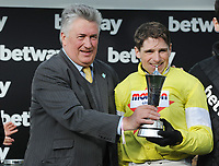 National Hunt Horse Racing - 2020 Cheltenham Festival - Wednesday, Day Two (Ladies Day)<br /> <br /> Winner, Harry Skelton on Politologue and Paul Nicholls with the trophy in the 15.30 Betway Queen Mother Champion Steeple chase (Grade 1), at Cheltenham Racecourse.<br /> <br /> COLORSPORT/ANDREW COWIE