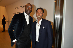 Left to right, OZWALD BOATENG and ROUBI L'ROUBI at Fashions for The Future presented by Oceana's Junior Council held at Phillips Auction House, 30 Berkeley Square, London on 19th March 2015.
