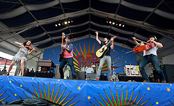 25 April 2014. New Orleans, Louisiana.<br /> The Avett Brothers play the New Orleans Jazz and Heritage Festival. <br /> L/R; Tania Elizabeth, Seth Avett,  Bob Crawford and Jo Kwon.<br /> Photo; Charlie Varley/varleypix.com