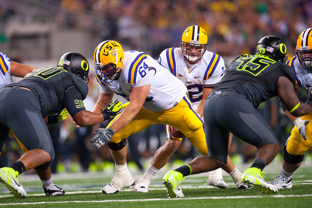 ARLINGTON, TX - SEPTEMBER 03: Center P.J. Lonergan #64 of the LSU Tigers blocks during the game against the Oregon Ducks during the Cowboys Classic at Cowboys Stadium on September 03, 2011 in Arlington, Texas. ( Photo by: Rob Tringali) *** Local Caption *** P.J. Lonergan