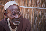 Chief Malik Diop in the village of Namzene Amar, K&eacute;b&eacute;mer Department, Senegal on February 23, 2017. Malik was operated on for trachoma but it was unsuccessful and is suffering from impaired vision. Teams composed of Ministry of Health staff and RTI staff traveled to K&eacute;b&eacute;mer to carry out a trachoma surveillance survey. The activity includes household visits to assess the eyelids of community members to check for any signs of ongoing transmission of trachoma.  K&eacute;b&eacute;mer was previously considered endemic for trachoma, but a recent impact survey found that the prevalence was below 5%, meaning treatment is no longer required. This survey assesses if there is any recurrence of transmission, or if the districts is on track to eliminate the disease. <br /> <br /> Senegal is endemic for trachoma and is currently working to eliminate the disease by 2020. USAID&rsquo;s ENVISION Project, led by RTI International, is helping Senegal&rsquo;s Minist&egrave;re de la Sant&egrave; et de l&rsquo;Action Sociale (Ministry of Health and Social Work) to achieve this goal, providing support for trachoma activities.