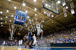 Duke guard Jon Scheyer (30) shoots against Virginia.  The Duke Blue Devils defeated the Virginia Cavaliers 87-65 in men's basketball at Cameron Indoor Stadium on the campus of Duke University in Durham, NC on January 13, 2008.