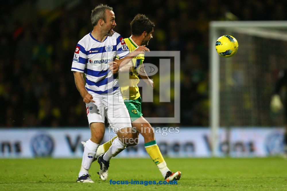 Picture by Paul Chesterton/Focus Images Ltd.  07904 640267.26/11/11.Andrew Surman of Norwich and Shaun Derry of QPR in action during the Barclays Premier League match at Carrow Road Stadium, Norwich.