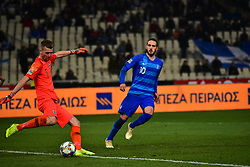 November 15, 2018 - Athens, Attiki, Greece - Goalkeeper of Finland Lukas Hradecky (no 1) shots the ball under the pressure of Kostas Fortounis (no 10) of Greece. (Credit Image: © Dimitrios Karvountzis/Pacific Press via ZUMA Wire)