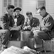 Four GI's peeling apples during some downtime toward the end of the war. April 1945