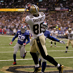 2009 October 18: New Orleans Saints tight end Jeremy Shockey (88) catches a touchdown over New York Giants linebacker Danny Clark (55) during the first quarter at the Louisiana Superdome in New Orleans, Louisiana.