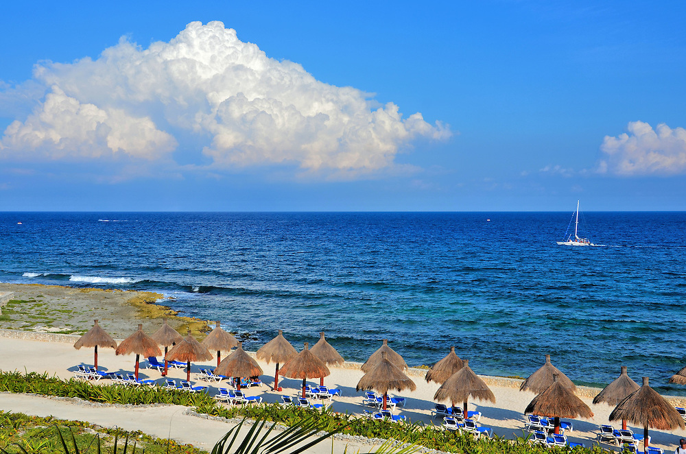 Thatched Umbrellas and Chaises Along Beachfront at Riviera Maya, Mexico <br />