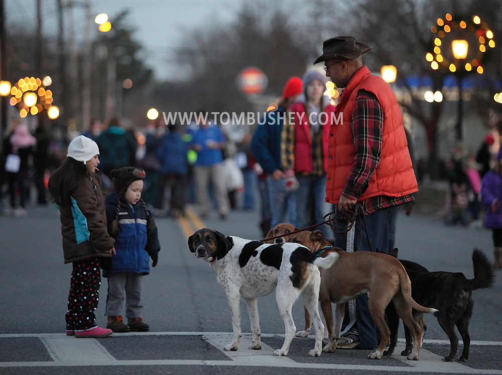 Pine Bush, New York  - Two children looks at a group of dogs a man was walking during A Community Country Christmas 2011 on the closed main street on  Dec. 3, 2011.