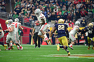 GLENDALE, AZ - JANUARY 01:  Wide receiver Braxton Miller #1 of the Ohio State Buckeyes hauls in a pass over safety Elijah Shumate #22 of the Notre Dame Fighting Irish during the first quarter of the BattleFrog Fiesta Bowl at University of Phoenix Stadium on January 1, 2016 in Glendale, Arizona.  (Photo by Jennifer Stewart/Getty Images)