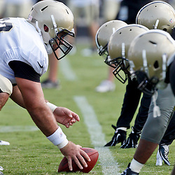 July 29, 2012; Metairie, LA, USA; New Orleans Saints guard Brian De La Puente (60) prepares to snap the ball during team drills in a training camp practice at the team's practice facility. Mandatory Credit: Derick E. Hingle-US PRESSWIRE