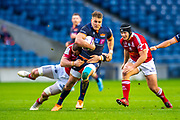 Duhan van der Merwe (#11) of Edinburgh Rugby is tackled by Romain Briatte (#6) of SU Agen Rugby during the European Rugby Challenge Cup match between Edinburgh Rugby and SU Agen at BT Murrayfield, Edinburgh, Scotland on 18 January 2020.