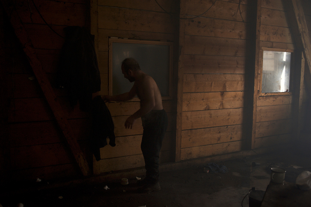 An afghan migrants washes himself inside the old warehouses near Belgrade's main railway station. The thousands of migrants living here do not have access to clean running water or shower facilities.