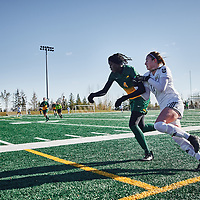 1st year defender, Amou Madol (4) of the Regina Cougars during the Women's Soccer home game on Sun Oct 14 at U of R Field. Credit: Arthur Ward/Arthur Images