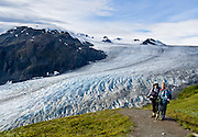 "Exit Glacier flows from the Harding Icefield in the Kenai Mountains of Alaska, USA. The only road into Kenai Fjords National Park is a spur of the Seward Highway to Exit Glacier, one of the most visited glaciers in Alaska. It was named after the exit of the first recorded crossing of Harding Icefield in 1968. Hike trails to the glacier terminus or up to Harding Icefield. From 1815-1999, the Exit Glacier in Alaska retreated 6549 feet, melting an average of 35 feet per year (according to www.nps.gov/kefj/). Over the past 50 years, Alaska's winters have warmed by 6.3°F (3.5°C) and its annual average temperature has increased 3.4°F (2.0°C) (Karl et al. 2009). Alaska has warmed more than twice as fast as the continental United States. Since the industrial revolution began, humans have increased atmospheric carbon dioxide concentration by 35% through burning fossil fuels, deforesting land, and grazing livestock. An overwhelming consensus of climate scientists agree that global warming is indeed happening and humans are contributing to it through emission of greenhouse gases (primarily carbon dioxide). The UN Intergovernmental Panel on Climate Change (IPCC, 2007) says ""Warming of the climate system is unequivocal, as is now evident from observations of increases in global average air and ocean temperatures, widespread melting of snow and ice and rising global average sea level. There is very high confidence that the net effect of human activities since 1750 has been one of warming."""
