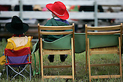 062009-Evergreen, Colo.-queenshc-2 young cowboys watch during the 2009 Evergreen Rodeo Queens Horsemanship Competition Saturday, June 20, 2009 at The Evergreen Rodeo Grounds..Photo By Matthew Jonas/Evergreen Newspapers/Photo Editor