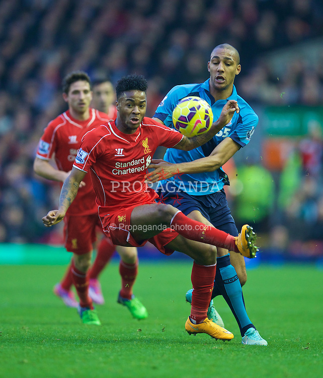 LIVERPOOL, ENGLAND - Saturday, November 29, 2014: Liverpool's Raheem Sterling in action against Stoke City's Steven N'Zonzi during the Premier League match at Anfield. (Pic by David Rawcliffe/Propaganda)