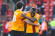 Aaron McLean of Bradford City (right) celebrated victory with Carl McHugh of Bradford City (left) after the Sky Bet League 1 match at the Matchroom Stadium, London<br /> Picture by David Horn/Focus Images Ltd +44 7545 970036<br /> 29/03/2014