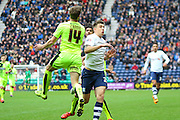 Preston North End Striker Jordan Hugill and Huddersfield Defender Martin Crainie battle during the Sky Bet Championship match between Preston North End and Huddersfield Town at Deepdale, Preston, England on 6 February 2016. Photo by Pete Burns.