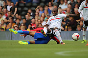 Crystal Palace attacker, Jason Puncheon (42) tackling Fulham striker, Sone Aluko during the Pre-Season Friendly match between Fulham and Crystal Palace at Craven Cottage, London, England on 30 July 2016. Photo by Matthew Redman.