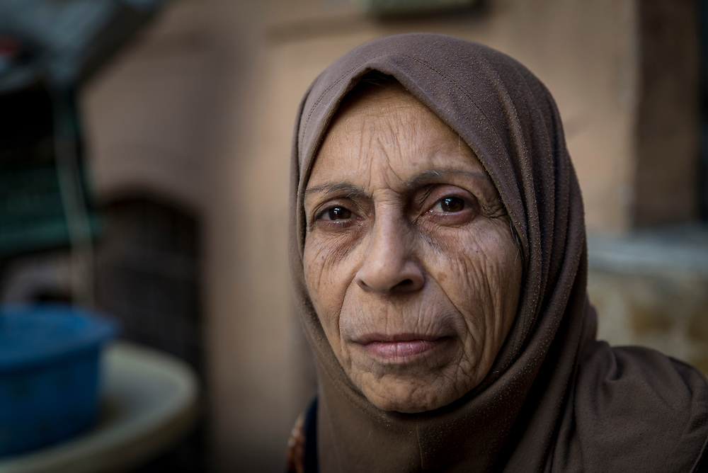 Nuhad Hamdoon, 64, sits inside her family home in the Old City of Mosul. She and her family returned home in February this year, after spending 8 months in a rented home in the east of the city. They fled their home in July last year, during the intense fighting between Iraqi forces and ISIS.