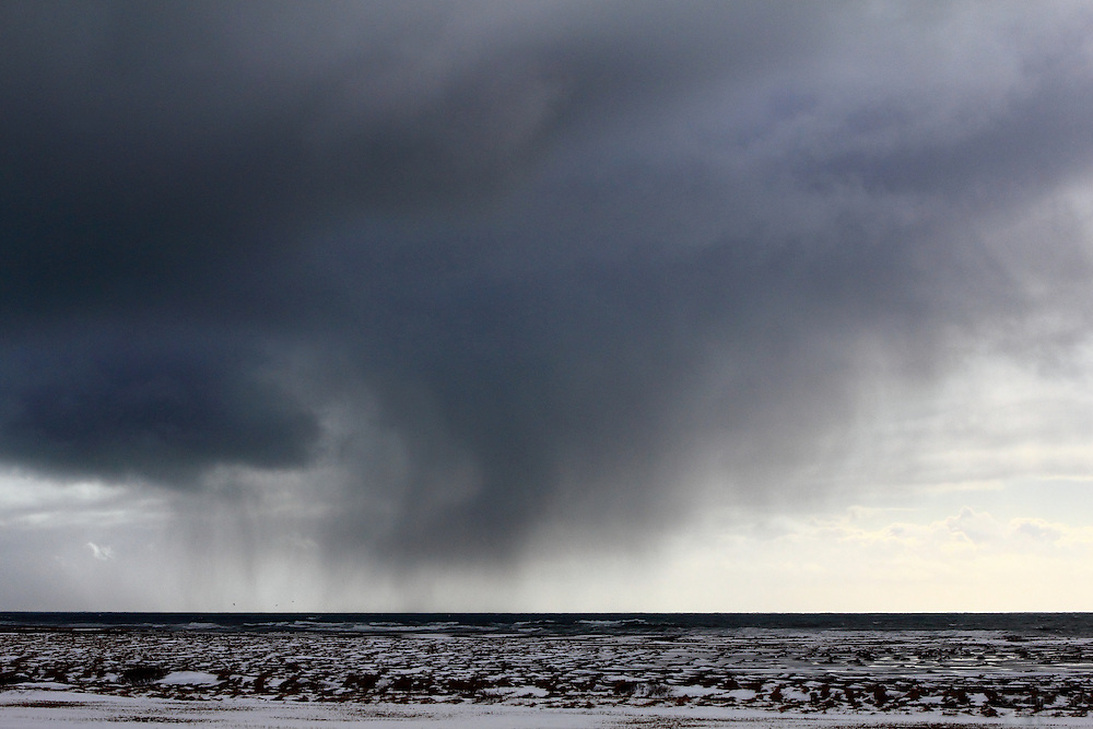Rain storms sweep over the south coast of the Snaefellsnes Peninsular in Western Iceland in late winter