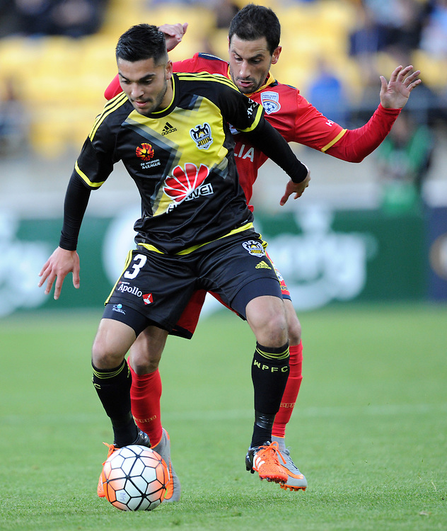 Phoenix's Justin Gulley, left, plays in front of Adelaide United's Sergio Cirio in the A-League football match at Westpac Stadium, Wellington, New Zealand, Friday, November 13, 2015. Credit:SNPA / Ross Setford