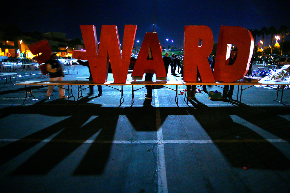 Supporters of John Edwards dismantling giant letters of the name Edwards after rallying outside the debate held between the Democratic Presidential Hopeful at the Cashman Center in Las Vegas.
