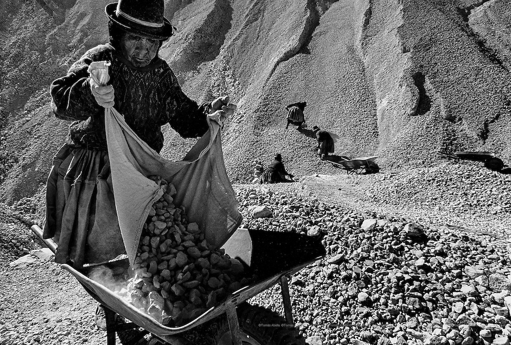 "When a miner dies in a gallery his widow is granted the right to be a ""palliri"". The ""palliri"" collect the rocks that the miners dispose of in order to recover the silver or tin remains they contain. Cerro Rico of Potosí. Bolivia."