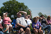 Spectators watch a performance by wingwalker Carol Pilon at the Dunkirk Air Show in Dunkirk, New York on Saturday, July 2, 2016.