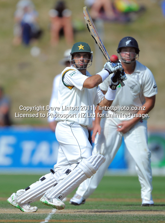 Pakistan captain Misbah ul-Haq hits out as Jesse Ryder looks on. 2nd cricket test match - New Zealand Black Caps v Pakistan, day three at the Basin Reserve, Wellington, New Zealand on Monday, 17 January 2011. Photo: Dave Lintott / photosport.co.nz