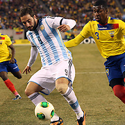 Gonzalo Higuaín, (left), Argentina, is challenged by Frickson Erazo, Ecuador, during the Argentina Vs Ecuador International friendly football match at MetLife Stadium, New Jersey. USA. 15th November 2013. Photo Tim Clayton