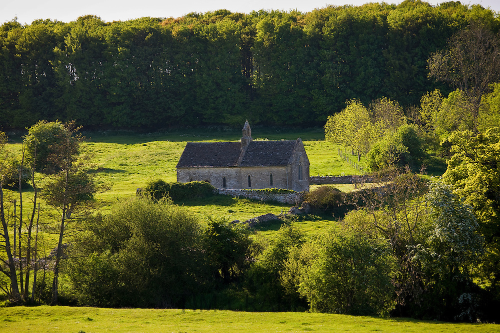 St Oswald's Church, an ancient tiny chapel in a field at Widford in The Cotswolds, Oxfordshire, UK