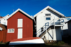 Traditional red and white wooden boat huts in village of Grundsund on Bohuslan Coast in Sweden