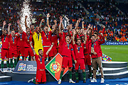Portugal forward Cristiano Ronaldo (7) holds the trophy and celebrates with his team mates winning the UEFA Nations League match between Portugal and Netherlands at Estadio do Dragao, Porto, Portugal on 9 June 2019.