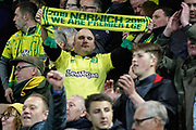 Norwich City fans with a Premier League scarf celebrating promotion after the EFL Sky Bet Championship match between Norwich City and Blackburn Rovers at Carrow Road, Norwich, England on 27 April 2019.