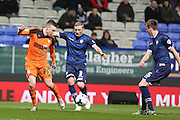 Freddie Sears, Ipswich Town forward tries to get away from Bolton Wanderers defender Dean Moxey in the box during the Sky Bet Championship match between Bolton Wanderers and Ipswich Town at the Macron Stadium, Bolton, England on 8 March 2016. Photo by Simon Brady.